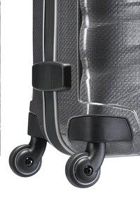 Samsonite Harde reistrolley Firelite Spinner grey 55 cm-Onderkant